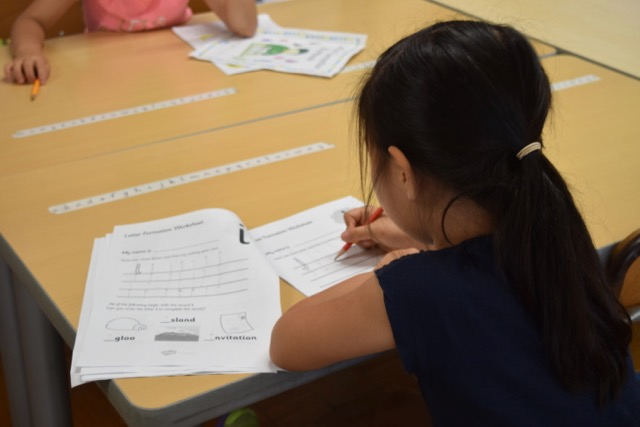 Pre-1st Graders Practice Their English by Writing Letters